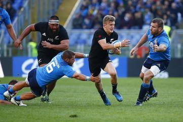 New Zealand's Damian McKenzie in action with Italy's Simone Favaro