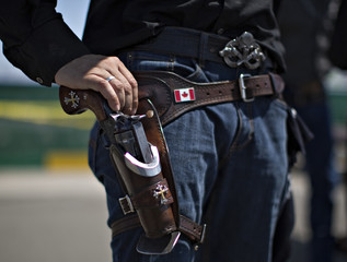 Yukon of Calgary rests his hand on his gun while waiting to compete in the Canadian Open Fast Draw Championships in Aldergrove