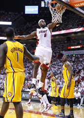 Miami Heat's James slam dunks against Indiana Pacers during their NBA Eastern Conference final basketball playoff in Miami