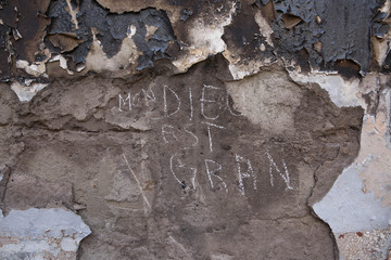 Words are seen written on the burnt wall of an evangelical church that was destroyed in riots demonstrating against Charlie Hebdo's cartoons of the Prophet Mohammad, in Niamey