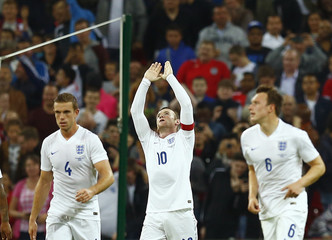 England captain Wayne Rooney celebrates after scoring his penalty during their international friendly soccer match against Norway at Wembley Stadium in London