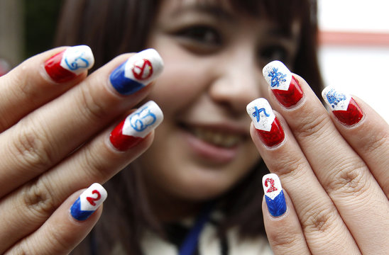 A supporter of Taiwan President and Nationalist Party (KMT) presidential candidate Ma Ying-jeou displays her manicured nails with Ma's name on it in Changhwa county
