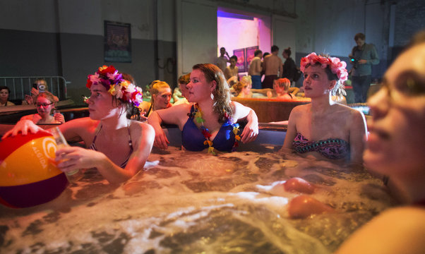 Movie fans enjoy a hot bubble bath while watching a movie at the Hot Tub Movie Club in Amsterdam