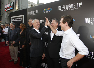 Director Emmerich actor Bill Pullman and his son Lewis Pullman arrive at the premiere of the film Independence Day: Resurgence in Hollywood