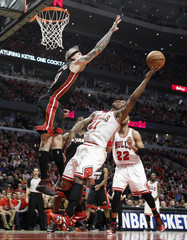 Miami Heat's Andersen tries to block shot of Chicago Bulls' Butler during Game 3 of their NBA Eastern Conference semi-finals basketball playoff series in Chicago