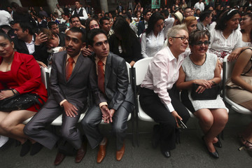 Gay couples take part in a mass wedding in Mexico City