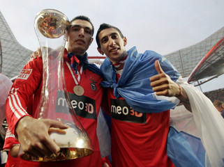 Benfica's Cardozo and Di Maria with the Portuguese Premier League trophy after beating Rio Ave at Luz stadium in Lisbon