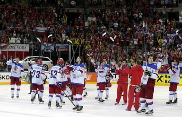 Russia's players wave to spectators before leaving the victory ceremony after the Ice Hockey World Championship final game in Prague