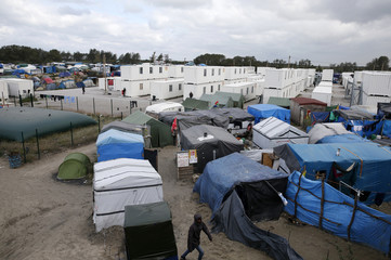 """A view shows makeshift shelters, tents and containers where migrants live in what is known as the """"Jungle"""", a sprawling camp in Calais"""