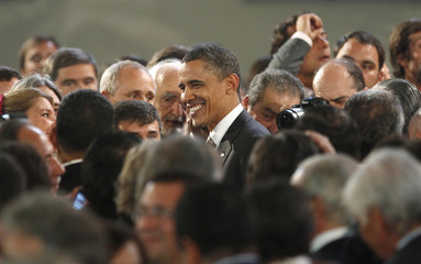 U.S. President Barack Obama makes his way through well-wishers at an official dinner at La Moneda Palace in Santiago