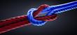 Kreuzknoten mit rotem und blauem Seil vor dunklem Hintergrund