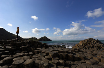 A woman poses for a picture on the rocks at the Giant's Causeway situated on the north coast of Northern Ireland.