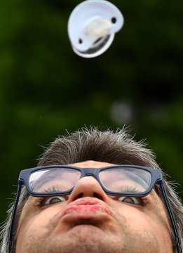 A participant takes part in the women's final of the pacifier spitting World Championship in Nidderau near Frankfurt