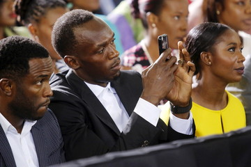 Bolt and Fraser-Pryce look on as Obama participates in a town hall meeting with young Caribbean leaders at the University of the West Indies in Kingston