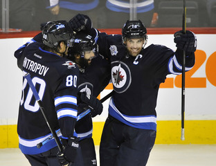 Winnipeg Jets' Ladd celebrates his goal against the Tampa Bay Lightning during their NHL game in Winnipeg