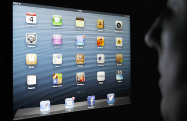 An illustration picture show application icons are displayed on an Apple Ipad tablet held by a woman  in Bordeaux