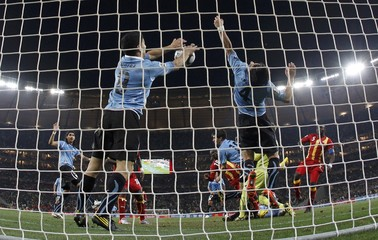 Uruguay's Suarez handles the ball at the goal line during extra time in the 2010 World Cup quarter-final soccer match against Ghana at Soccer City stadium in Johannesburg