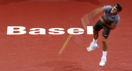 Switzerland's Federer serves the ball to Roddick of the U.S. during their semi-final match at the Swiss Indoors ATP tennis tournament in Basel