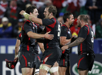 Wales players celebrate after beating Namibia in their Rugby World Cup Pool D match at Stadium Taranaki in New Plymouth