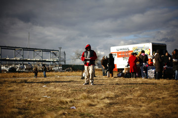 Man receives donated food in the Rockaways section in the Queens borough of New York