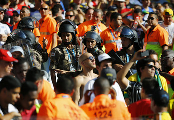 Stewards and police are pictured at the stands amid fans during the 2014 World Cup Group D soccer match between Costa Rica and England at the Mineirao stadium in Belo Horizonte