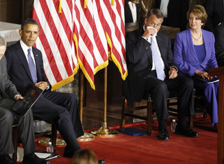 U.S. President Barack Obama sits alongside Boehner and Pelosi at the unveiling of a statue in honor of civil rights activist Rosa Parks, in Statuary Hall in the U.S. Capitol in Washington