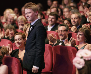 Cast members Doret and De France react as directors Dardenne receive the Grand Prix award  during the closing ceremony of the 64th Cannes Film Festival