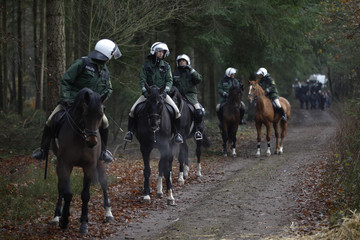 Mounted police officers watch the area next to the railway track in the small village of Leitstade near Dannenberg