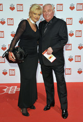 Boxing coach Wegner and wife Margit arrive for A Heart for Children TV charity telethon in Berlin