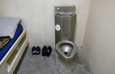 The interior of an unoccupied cell showing standard issue clothing given to prisoners is seen at Camp VI, a prison used to house detainees at the U.S. Naval Base at Guantanamo Bay