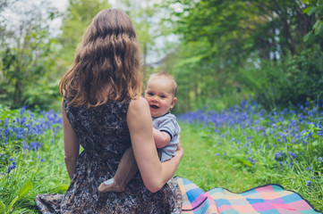Woman with baby in meadow