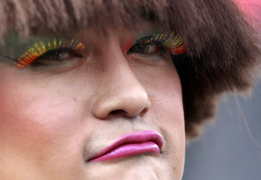 A participant poses with rainbow-colored eyelashes during the Taiwan LGBT Pride Parade in Taipei