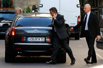 Former French President Nicolas Sarkozy speaks on his cellphone in Paris