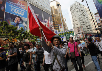 A protester dressed as a soldier chants slogans outside a Japanese department store during a protest march in Hong Kong