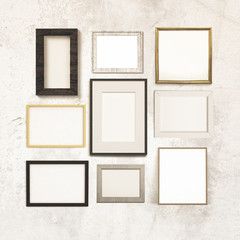 gallery of frames hanging on a grunge wall