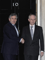 Britain's Prime Minister Gordon Brown greets European Council President Herman Van Rompuy on the steps of 10 Downing Street in London