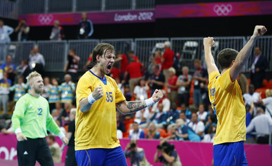 Sweden's Andreas Nilsson celebrates with teammates after their men's handball quarterfinal match against Denmark at the London 2012 Olympic Games