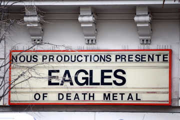 An advertising board for the music band The Eagles of Death Metal is seen at the entrance of the Bataclan concert hall, one of the sites of the deadly attacks in Paris, France