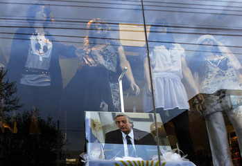 A picture of former Argentine President Kirchner is seen on display at a store in his hometown of Rio Gallegos