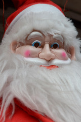 Rubber Mask of Santa Claus, a very high quality as the face of a man, a white Ford, a mustache, a red cap, a character for the Christmas.