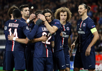 Paris St Germain's Edinson Cavani celebrates with team mates after he scored against Ajax Amsterdam's during their Champions League Group F soccer match at the Parc des Princes Stadium in Pari