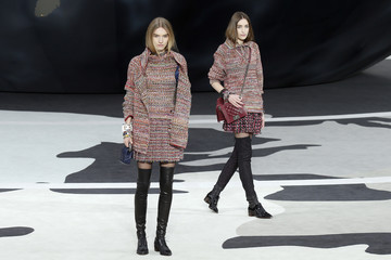 Models present creations by German designer Lagerfeld for French fashion house Chanel as part of his Fall-Winter 2013/2014 women's ready-to-wear fashion show during Paris fashion week