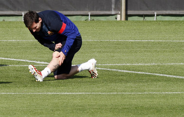 Barcelona's Lionel Messi stretches during a training session at Ciutat Esportiva Joan Gamper in Sant Joan Despi