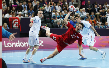 South Korea's Eom Hyowon takes a shot against Serbia in their men's handball Preliminaries Group B match at the Copper Box venue during the London 2012 Olympic Games