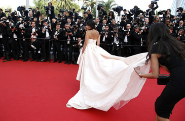 """Actress Leila Bekhti poses  on the red carpet as she arrives for the opening ceremony and the screening of the film """"La tete haute"""" out of competition during the 68th Cannes Film Festival in Cannes"""