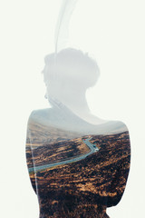 Woman with feather as a silhouette in double exposure