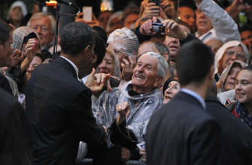 U.S. President Barack Obama shakes hands with residents at an event honoring the alliance between the United States and France, after the G20 Summit in Cannes
