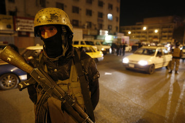 A member of Iraq's security forces stands guard at Tahrir Square in Baghdad