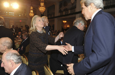 U.S. Secretary of State Hillary Clinton greets Senator John Kerry, (D-MA) at the 2012 Saban Forum on U.S.-Israel Relations at the Willard Intercontinental Hotel in Washington
