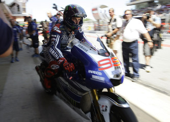 Yamaha MotoGP rider Lorenzo of Spain rides to the track during the qualifying session of the Catalunya Grand Prix near Barcelona